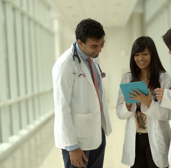 medical students looking at a tablet